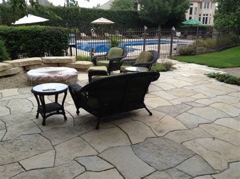 Patio Orland Park by Heritage Garden Shows Plantings Between Hardscapes