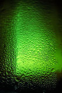 water drops texture on the green bottle of beer   stock