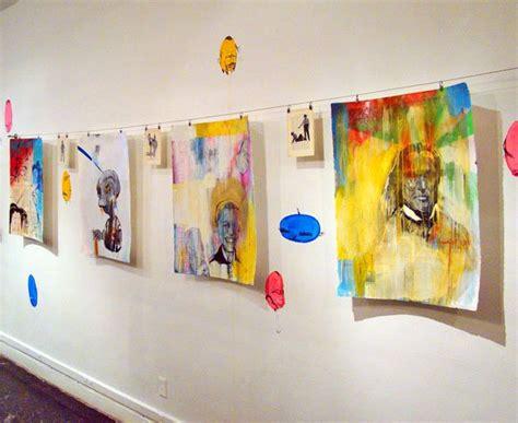 hanging artwork how to hang unframed popsugar home