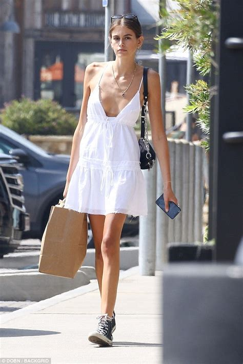 kaia gerber clothes kaia gerber looks summer chic in a white cotton dress and