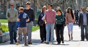 Wrong Poloshirt Rown Division prospective students and their parents stroll across ucsb