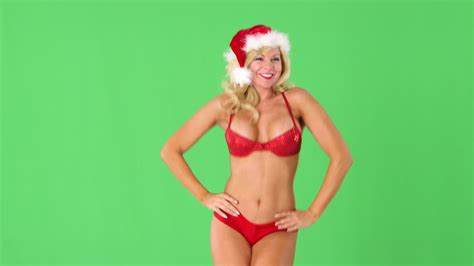 sexy young girl in santa hat blowing kisses hi res 12022091