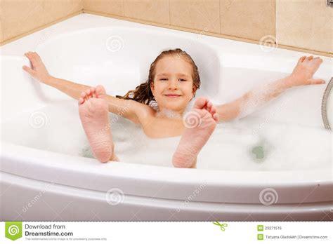 Child in the bathtub stock photo. Image of person, bubbles