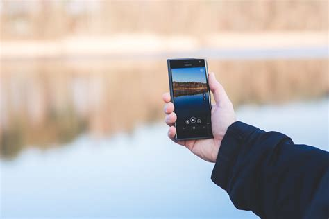 phone photography man taking photo of a lake with mobile phone 183 free stock