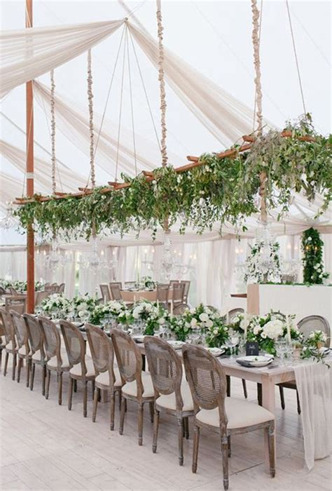 hanging trellis covered in greenery brides