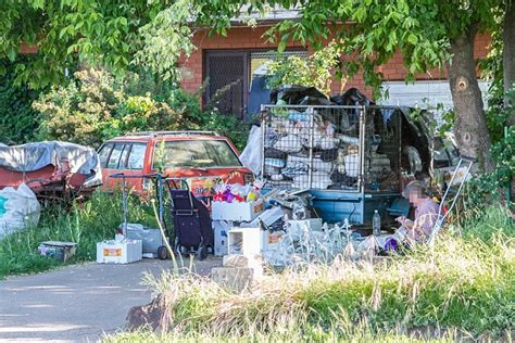 Garden City Trailer Park Hoarder Casually Sews In Front Yard Among