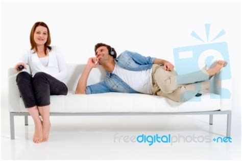 lying on the couch couple lying on the couch stock photo royalty free image