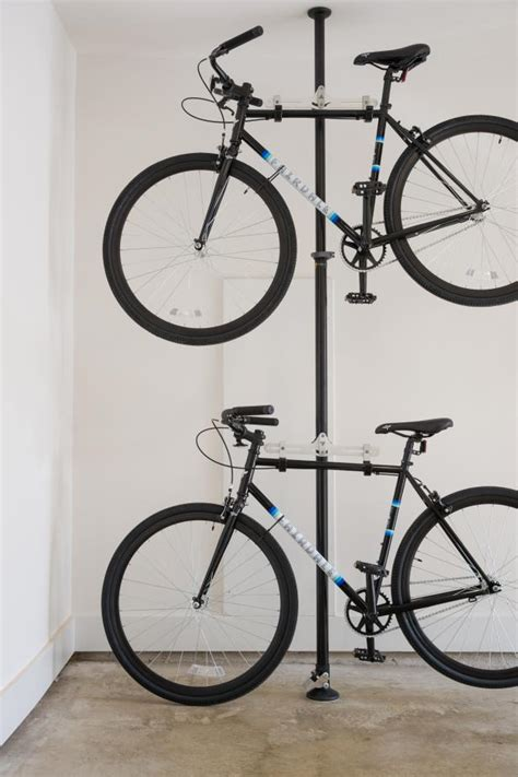 how to hang bicycles from the ceiling garage bike storage rack ideas to minimize visual clutter midcityeast