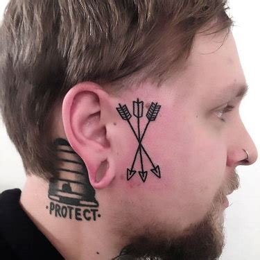 small tattoos on face cool on neck idea