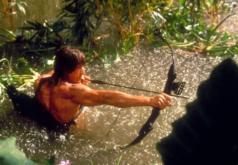 film rambo bow sylvester stallone popping out of the water with his hoyt
