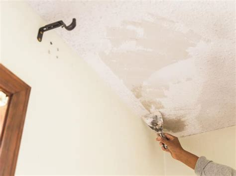 Taking Popcorn Ceiling by How To Remove A Popcorn Ceiling How Tos Diy