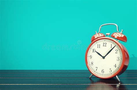 red retro alarm clock  blue background  space stock