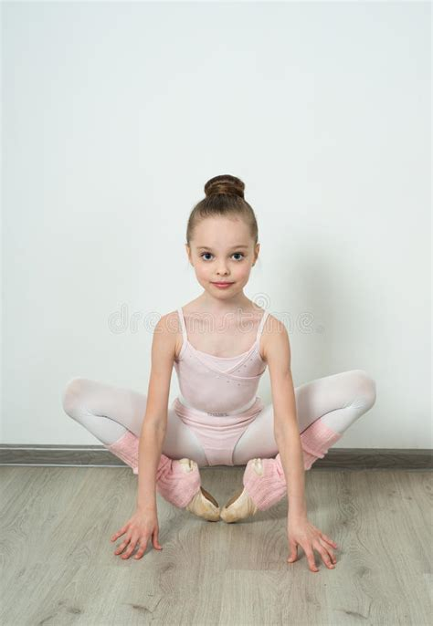 little young girl paradise a little adorable young ballerina does ballet poses stock