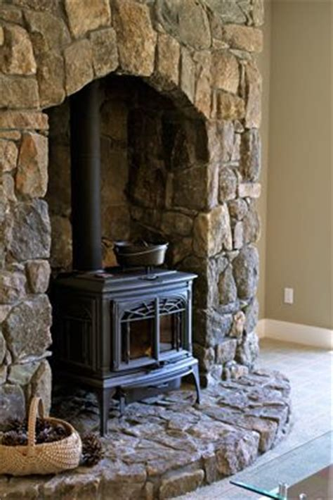 Wood Stove Inside Fireplace by This Free Standing Wood Stove Inside A Fireplace By