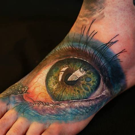 eye tattoo green big green eye tattoo on foot by cris gherman