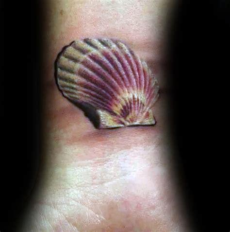 dashing seashell wrist tattoos
