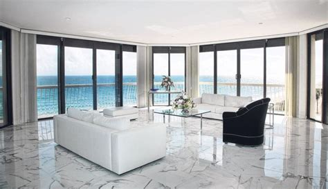 1 White Marble Floor Design - living room with a white polished marble floor and with a