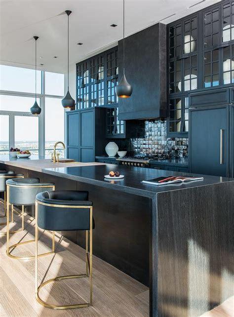 kitchen with black iridescent tile backsplash