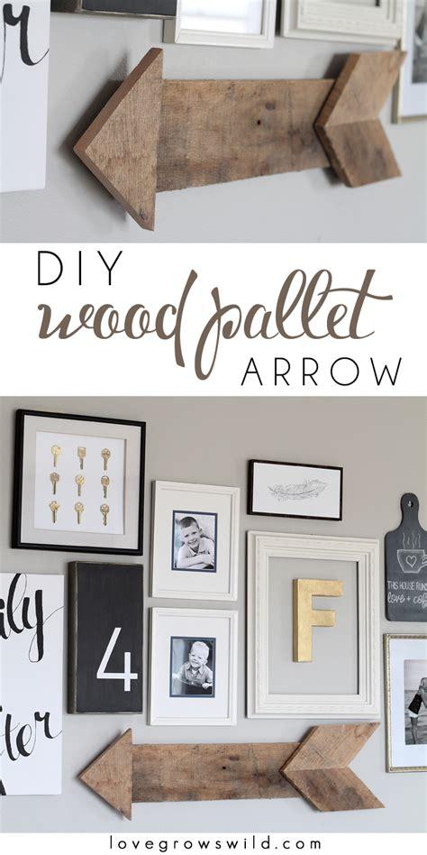 living room gallery wall love grows wild diy wood pallet arrow love grows wild