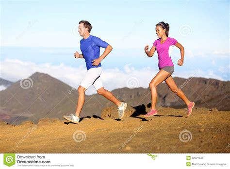 Sport Running running sport runners in trail run stock photo