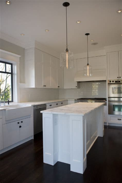 West 4th Renovation Featuring Niche Modern Bell Jar Light Pendants For Kitchen Island