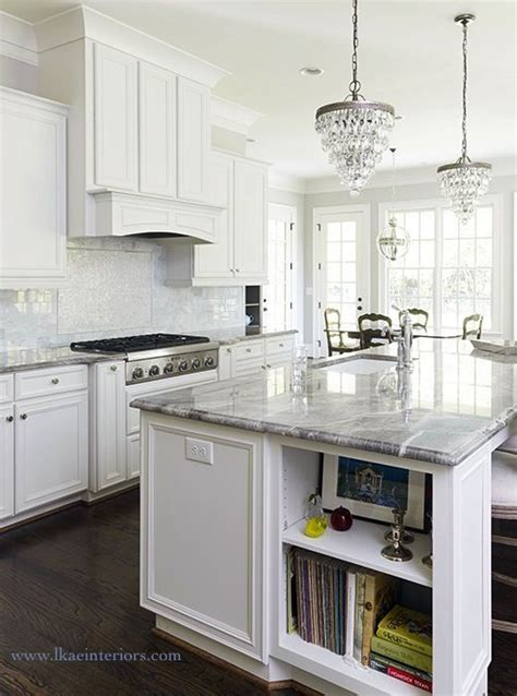stunning white kitchen features a pair of pottery barn