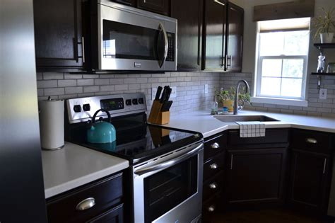 backsplash for cabinets and light countertops hometalk kitchen reveal cabinets light counters