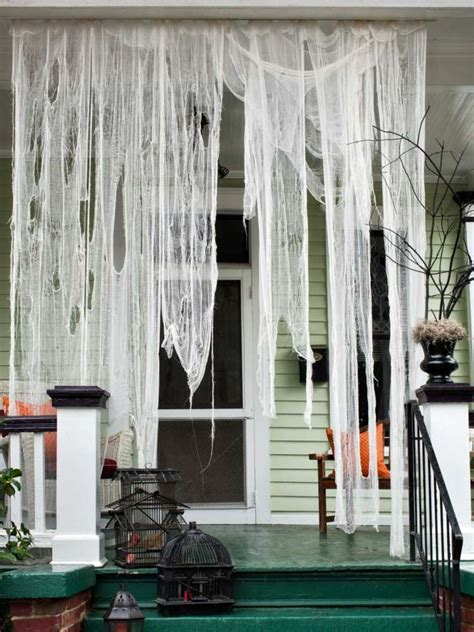 cheesecloth curtains 15 haunted halloween decor ideas for your front porch
