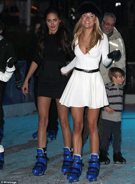 Dress Mic Mol kimberley garner goes bare legged as she takes a spin on the rink in a skater style