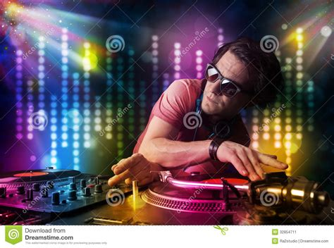 light show to music app dj playing songs in a disco with light show royalty free