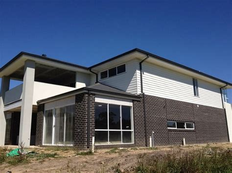 colorbond surfmist render  weatherboards facade house