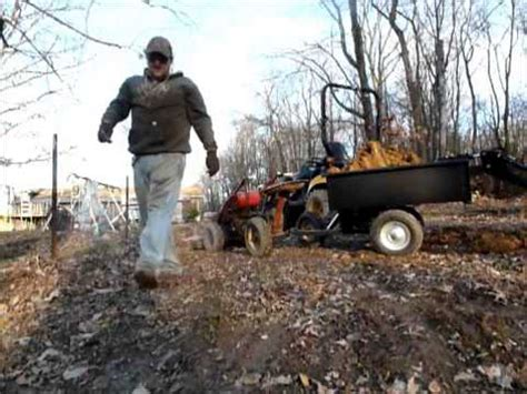 Walks Out Dumps The by Yanmar Loading The Dump Cart On A Gravely Walk