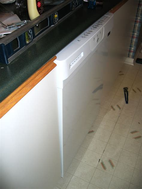 cabinet opening for dishwasher see it sticks out into the walkway not flush with the