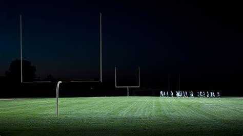 under the lights football communities shine bright under the friday night lights