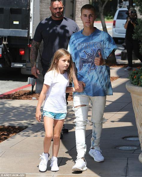 justin bieber biography siblings justin bieber holds little sister jazmyn s hand as he