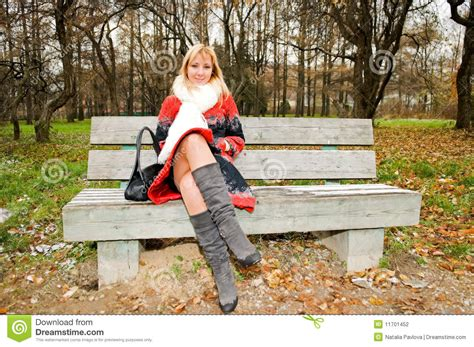 woman sitting on bench young woman sitting on the bench stock photography image