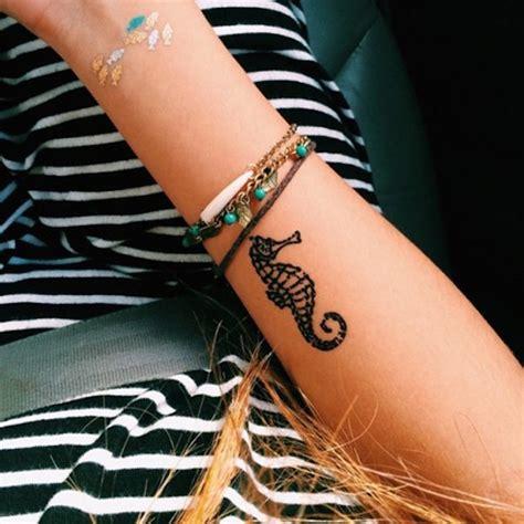 tattoo on wrist risks the ultimate list of small wrist tattoos that will turn