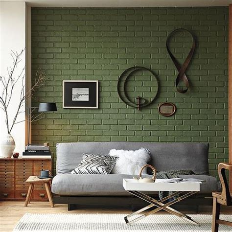 grey couch green brick wall residential interior design