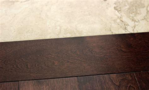 hardwood transitions stripe to tile   Carpet, Laminate