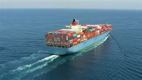 boats net shipping aerial shot of container ship in ocean stock footage video