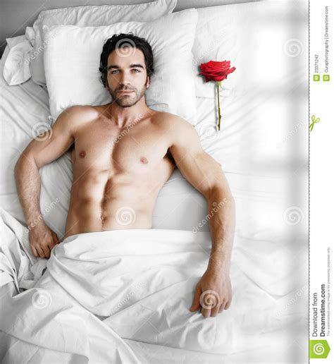 the bed guy man in bed with rose stock photography image 23371242