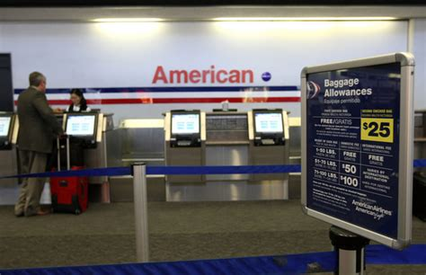 american airlines checked baggage american cuts flights to charge for first checked bag