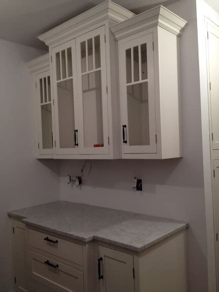 shaker kitchen cabinet crown molding buffet built of white shaker cabinets with glass doors and