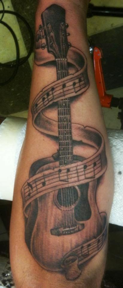 lucky 38 tattoos black and grey guitar with notes by
