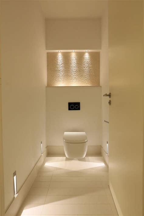 Stylish Bathroom Lighting Ideas Floating Toilet And Bathroom Lighting With Accent Walls Also Tile Floorings And Interior