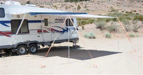 carefree electric awning manual awning extend r can nearly double rv canopy coverage www trailerlife com
