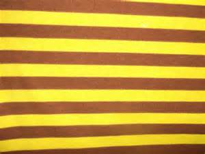 yellow brown wild ones yellow brown stripes on cotton interlock fabric