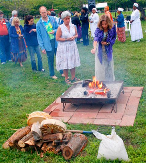 participants give tobacco prayers into the sacred fire to