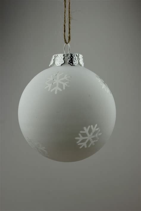 new frosted white christmas balls with snowflake cutout