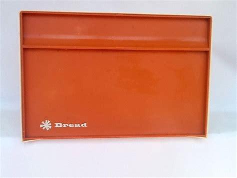 vintage orange and bakelite bread box with interior